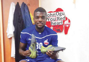 Nigerian midfielder John Ogu shows off new nike boots