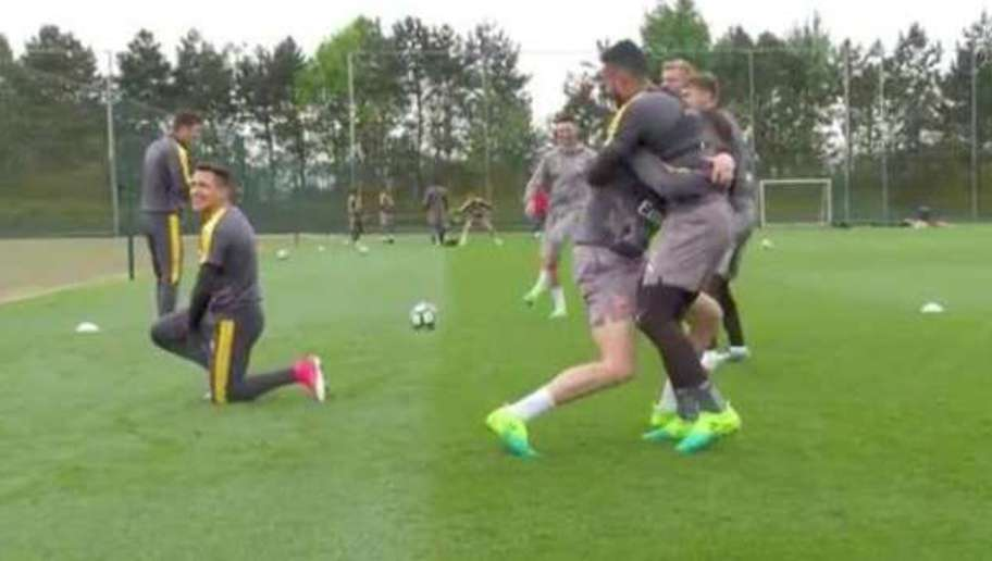 VIDEO: Oh Nuts! Alexis Sanchez Gets Megged by Arsenal Team-Mate in Hilarious Fashion