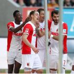Baba Rahman celebrates Augsburg's first Bundesliga win in five matches