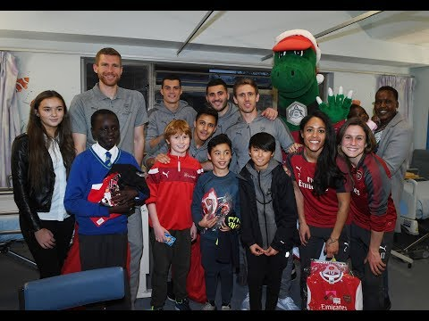 Arsenal players spread some festive cheer in local hospitals and schools