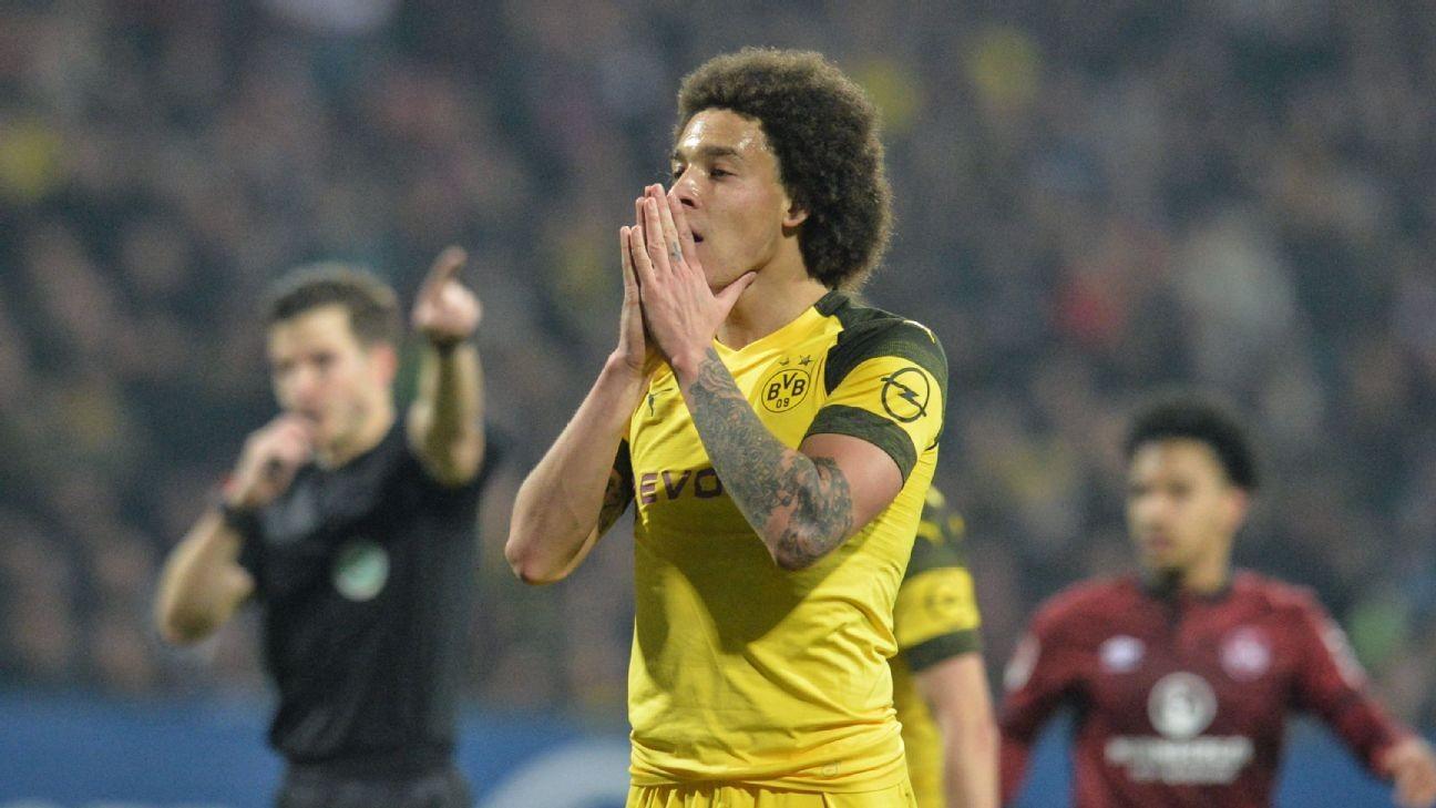 Dortmund drop more points in Nurnberg draw, Bayern deficit down to three