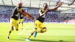 Southampton off the mark with win over 10-man Brighton