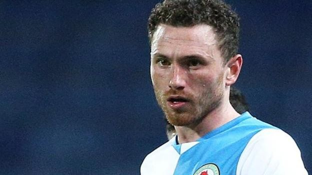 Corry Evans: Blackburn midfielder fractures skull and shatters eye socket